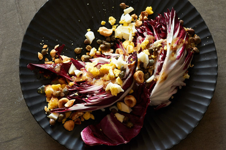 """<strong>Get the <a href=""""http://food52.com/recipes/26995-radicchio-salad-with-toasted-hazelnuts-and-capers"""" target=""""_blank"""">R"""
