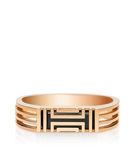 """Get it <a href=""""http://www.toryburch.com/tory-burch-for-fitbit-metal-hinged-bracelet/22145974.html?dwvar_22145974_color=650&s"""