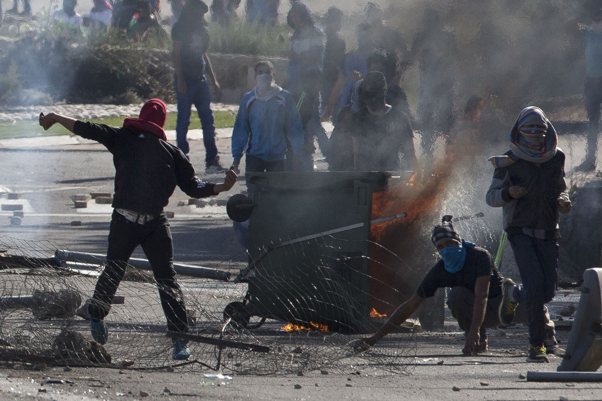 Israeli Arabs clash with Israeli riot police during a protest over the fatal shooting of a 22-year-old Arab Israeli who appea