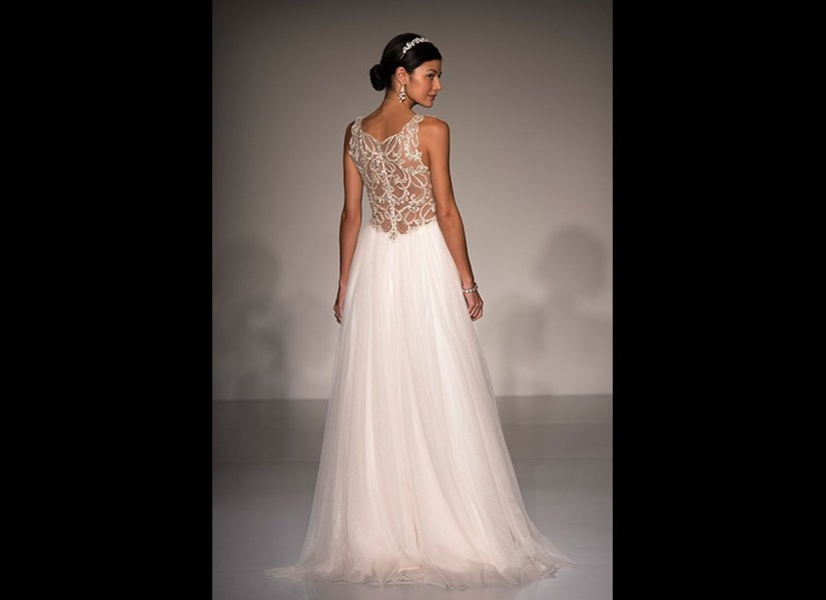 """Gown by <a href=""""http://www.maggiesottero.com"""" target=""""_hplink""""><strong>Maggie Sottero</strong></a>.<br><br><a href=""""http://w"""