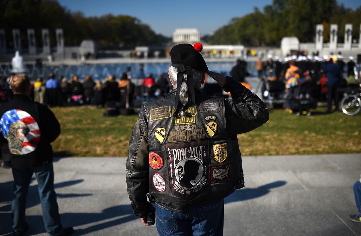 "WASHINGTON, DC - NOVEMBER 11:  Vietnam war veteran Joe ""'Dragon"""" Lozano, retired U.S. Army, salutes during the playing of ""'"