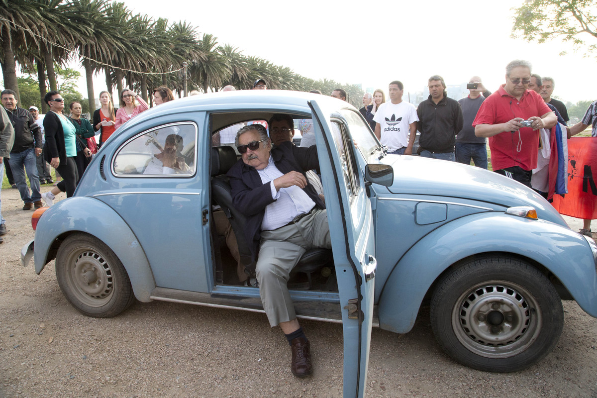 Uruguay's President Jose Mujica arrives at a polling station in his Volkswagen beetle, to cast his vote in the general electi