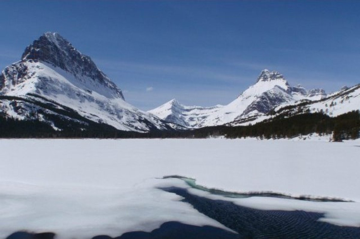 Known for its alpine meadows and rugged mountains, Glacier National Park is a gorgeous place to visit in the wintertime. Visi