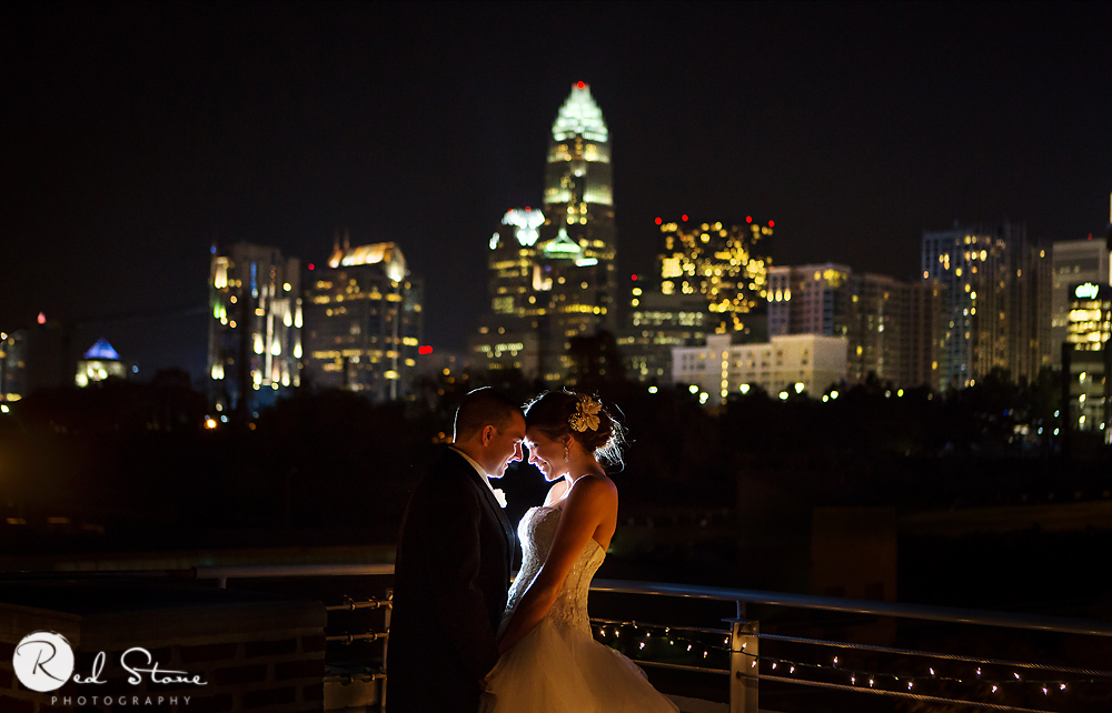 """Billy and Sam were married in Charlotte, North Carolina and the skyline was the beautiful backdrop to their celebration!"" -"