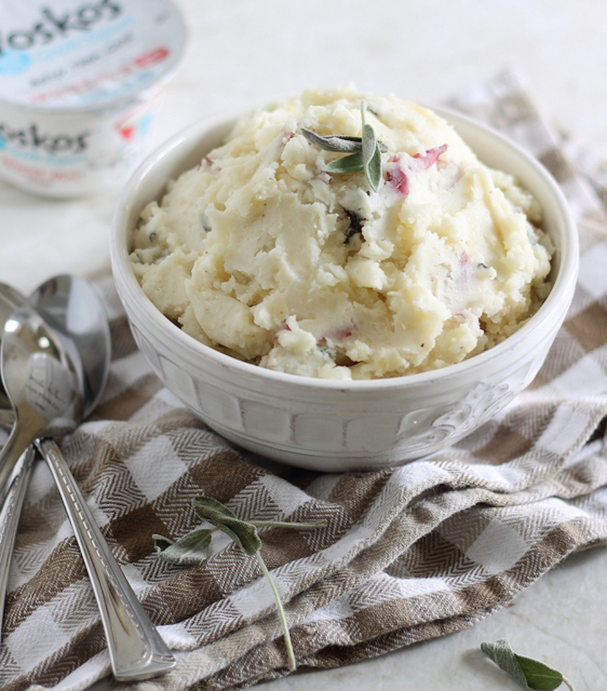 You won't feel like anything is missing from your beloved mashed potatoes when Greek yogurt is involved: It'll add a tart, cr