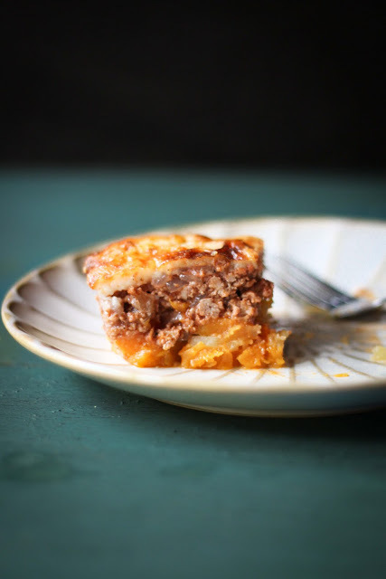 """<strong>Get the <a href=""""http://www.adventures-in-cooking.com/2011/06/mousaka-with-butternut-squash-and-sweet.html"""" target=""""_"""