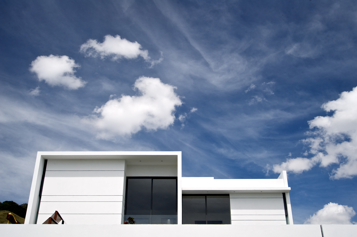 The home's pure white exterior matches perfectly with a bright day.
