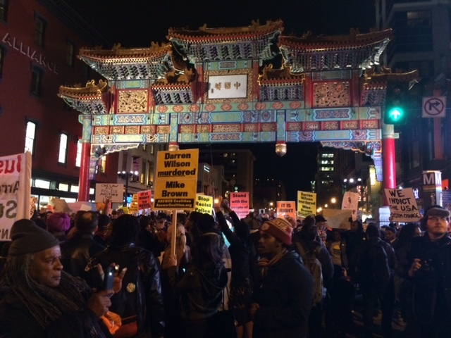 Protesters gather in Washington, D.C.'s Chinatown Tuesday evening.