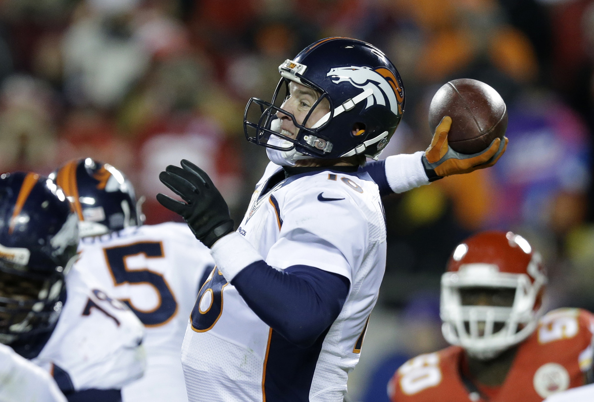Denver Broncos quarterback Peyton Manning (18) throws in the second half of an NFL football game against the Kansas City Chie