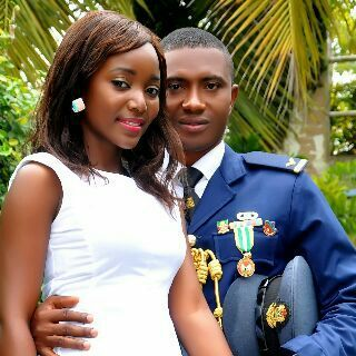 """""""Flying officer Ashandobe of the Nigerian Air Force and his bride after their wedding at Navy Town, lagos, Nigeria."""" - Hassan"""