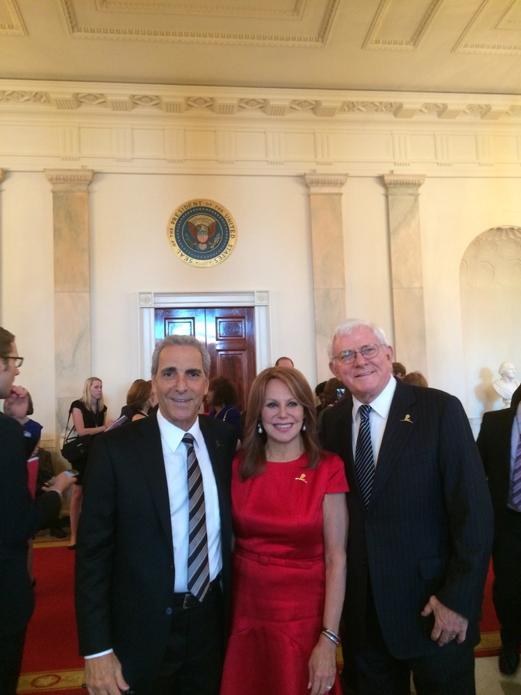 My brother Tony, my husband, Phil -- and the Presidential Seal over our heads!