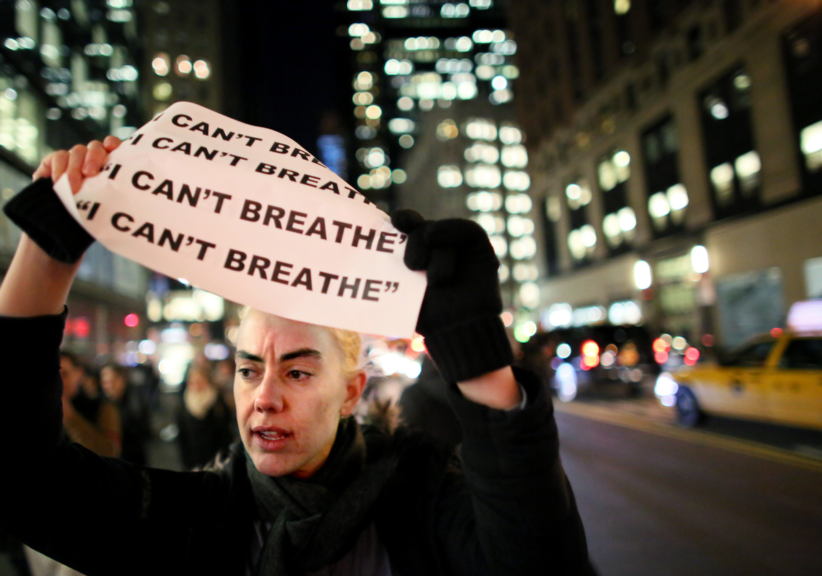 NEW YORK - DECEMBER 3: Demonstrators walk together during a protest December 3, 2014 in New York. Protests began after a Gran
