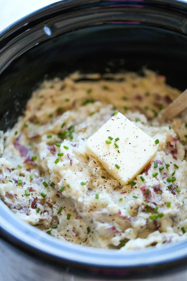 "<strong>Get the <a href=""http://damndelicious.net/2014/11/14/slow-cooker-garlic-mashed-potatoes/"" target=""_blank"">Slow Cooker"