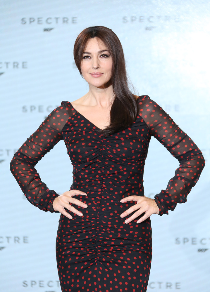 Actress Monica Bellucci poses for photographers at the announcement for the new Bond film, the 24th in the series, at Pinewoo