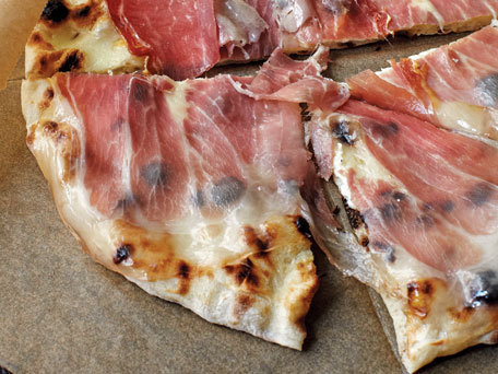 """<strong>Get the <a href=""""http://www.huffingtonpost.com/2012/03/20/pizza-dough_n_1367825.html"""">Pizza Dough</a> recipe</strong>"""