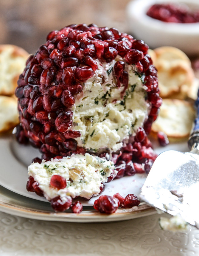 """<strong>Get the <a href=""""http://www.howsweeteats.com/2013/12/pomegranate-jeweled-white-cheddar-toasted-almond-and-crispy-sage"""