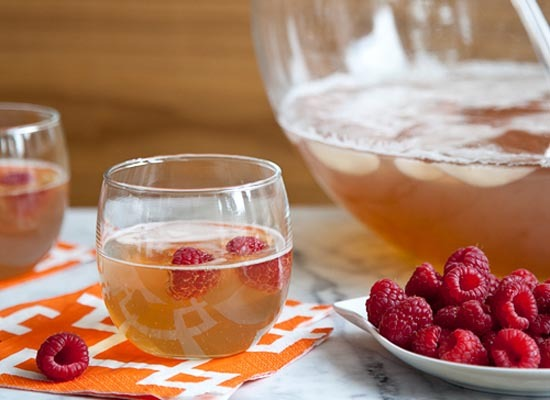 "<strong>Get the <a href=""http://www.foodiecrush.com/2011/12/new-year-champagne-punch/"">Raspberry Champagne Punch recipe</a> b"