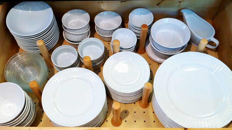 If you're tired of standing on your tippy-toes to reach your plates, try storing dishes in a deep pullout drawer for easier a