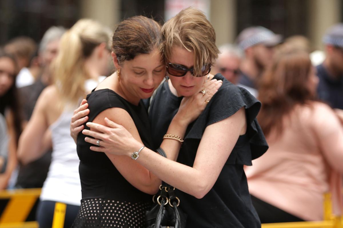 SYDNEY, AUSTRALIA - DECEMBER 16:  Women comfort eachother in Martin Place on December 16, 2014 in Sydney, Australia. Sydney s