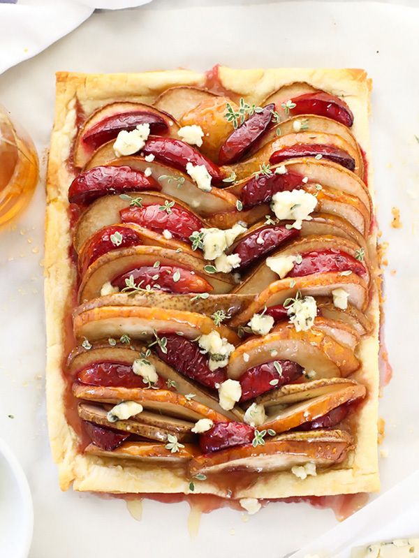 "<strong>Get the <a href=""http://www.foodiecrush.com/2014/10/pear-and-plum-puff-pastry-tart-with-blue-cheese/"" target=""_blank"""