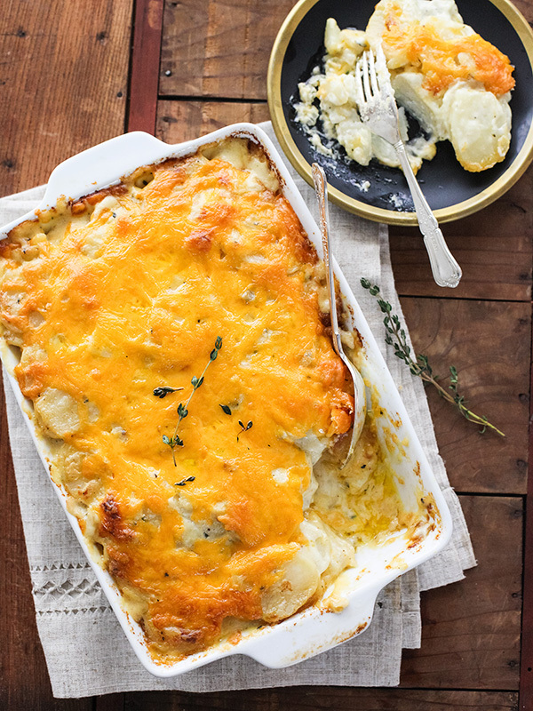"<strong>Get the <a href=""http://www.foodiecrush.com/2014/04/cheesy-scalloped-potatoes/"" target=""_blank"">Cheesy Scalloped Pota"