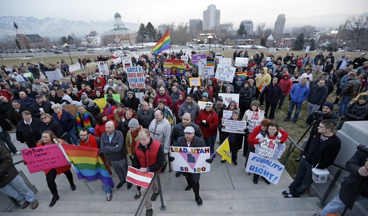 Supporters of gay marriage gather for a rally at the Utah State Capitol, Tuesday, Jan. 28, 2014, in Salt Lake City. More than