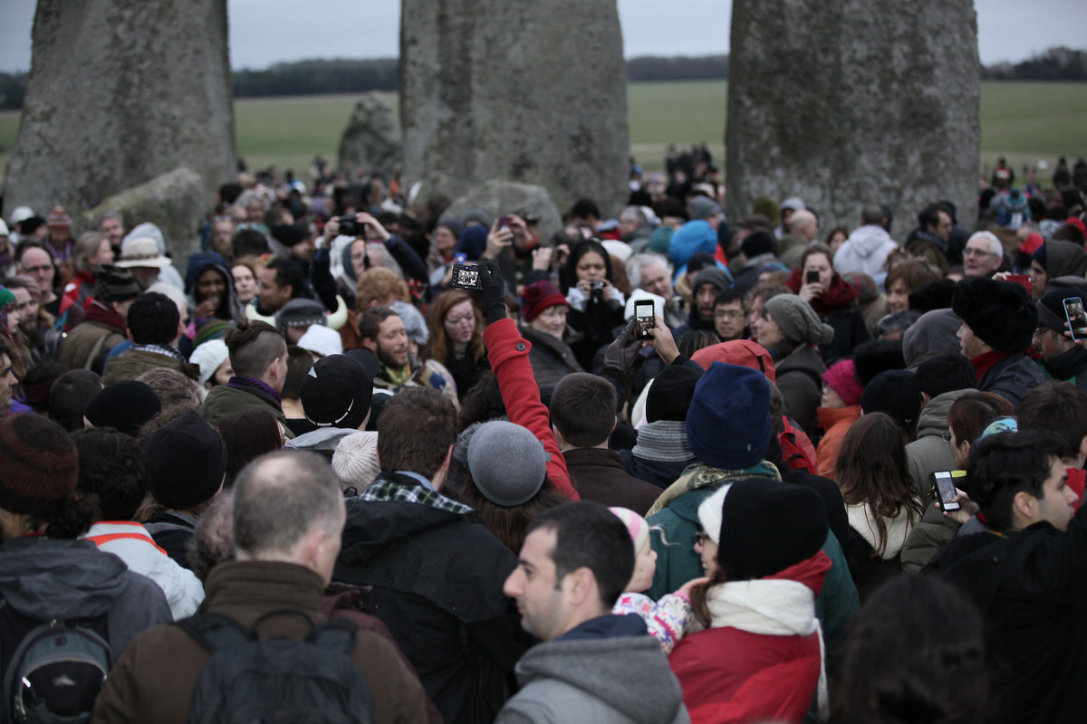 People gather at the historic site of  Stonehenge, southwest England to celebrate the Winter solstice Monday Dec. 22, 2014. (