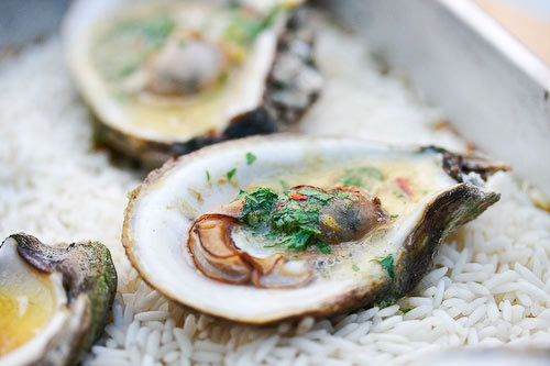 """<strong>Get the <a href=""""http://www.simplyrecipes.com/recipes/grilled_oysters/"""">Grilled Oysters recipe</a> from Simply Recipe"""
