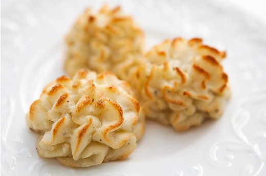 "<strong>Get the <a href=""http://www.simplyrecipes.com/recipes/duchess_potatoes/"" target=""_blank"">Duchess Potatoes recipe</a>"