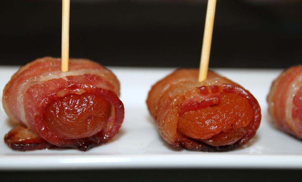 """<strong>Get the <a href=""""http://food52.com/recipes/15308-bacon-wrapped-apricots-stuffed-with-pistachios-and-mozzarella"""" targe"""