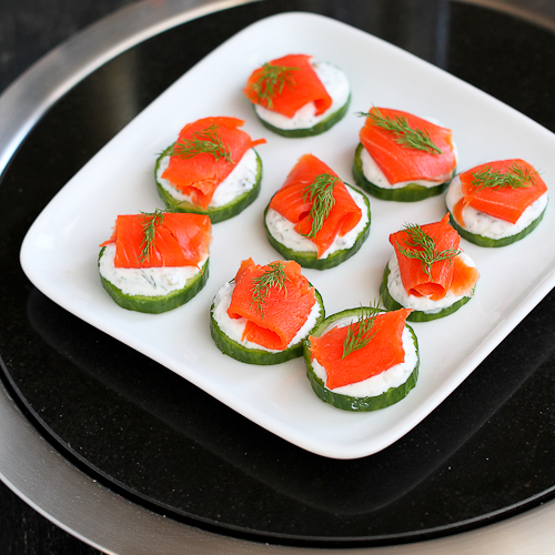 """<strong>Get the <a href=""""http://www.cookincanuck.com/2013/12/smoked-cucumber-appetizer-recipe-with-caper-yogurt/"""" target=""""_bl"""