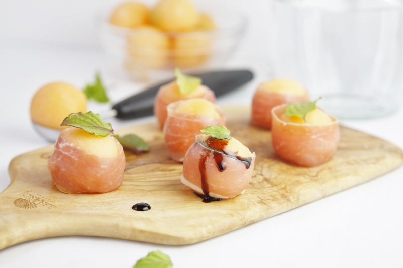 """<strong>Get the <a href=""""http://www.bellalimento.com/2013/08/26/prosciutto-wrapped-melon-balls/"""" target=""""_blank"""">Prosciutto W"""