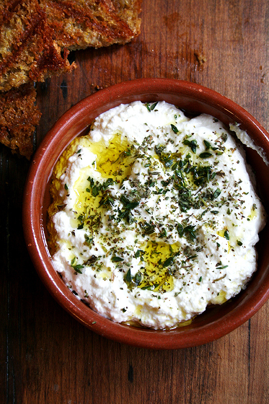 """<strong>Get the <a href=""""http://www.alexandracooks.com/2013/06/20/ricotta-with-thyme-olive-oil-grilled-bread/"""" target=""""_blank"""