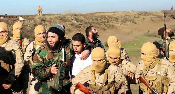 This image posted by the Raqqa Media Center of the Islamic State group, a militant extremist group shows members of the Islam