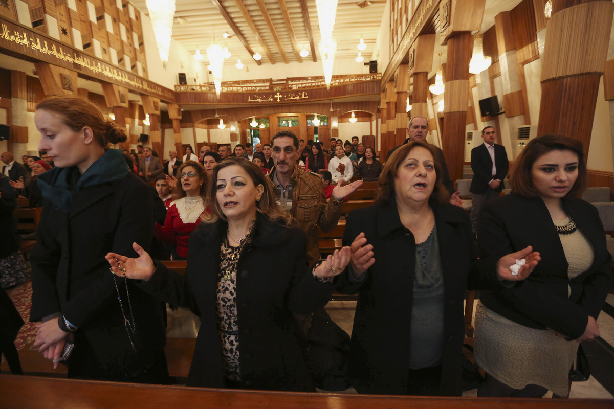 Iraqi Christians attend a Christmas Eve mass at Our Lady of Salvation in Baghdad, Iraq, Wednesday, Dec. 24, 2014. Iraqi Chris