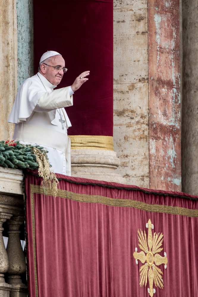 VATICAN CITY, VATICAN - DECEMBER 25:  Pope Francis waves to the faithful as he delivers his Christmas Day message from the ce