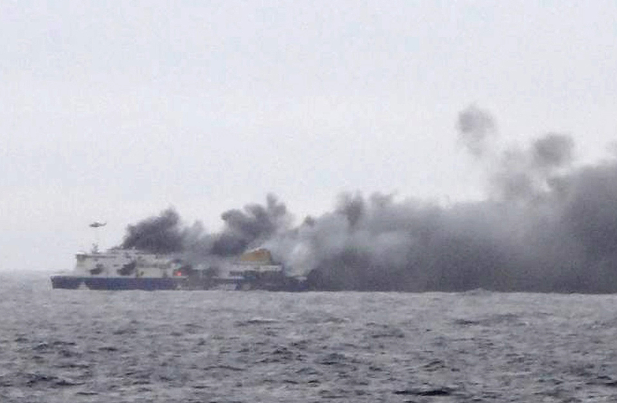 In this photo taken from a nearby ship, smoke rises from the Italian-flagged Norman Atlantic after it caught fire in the Adri