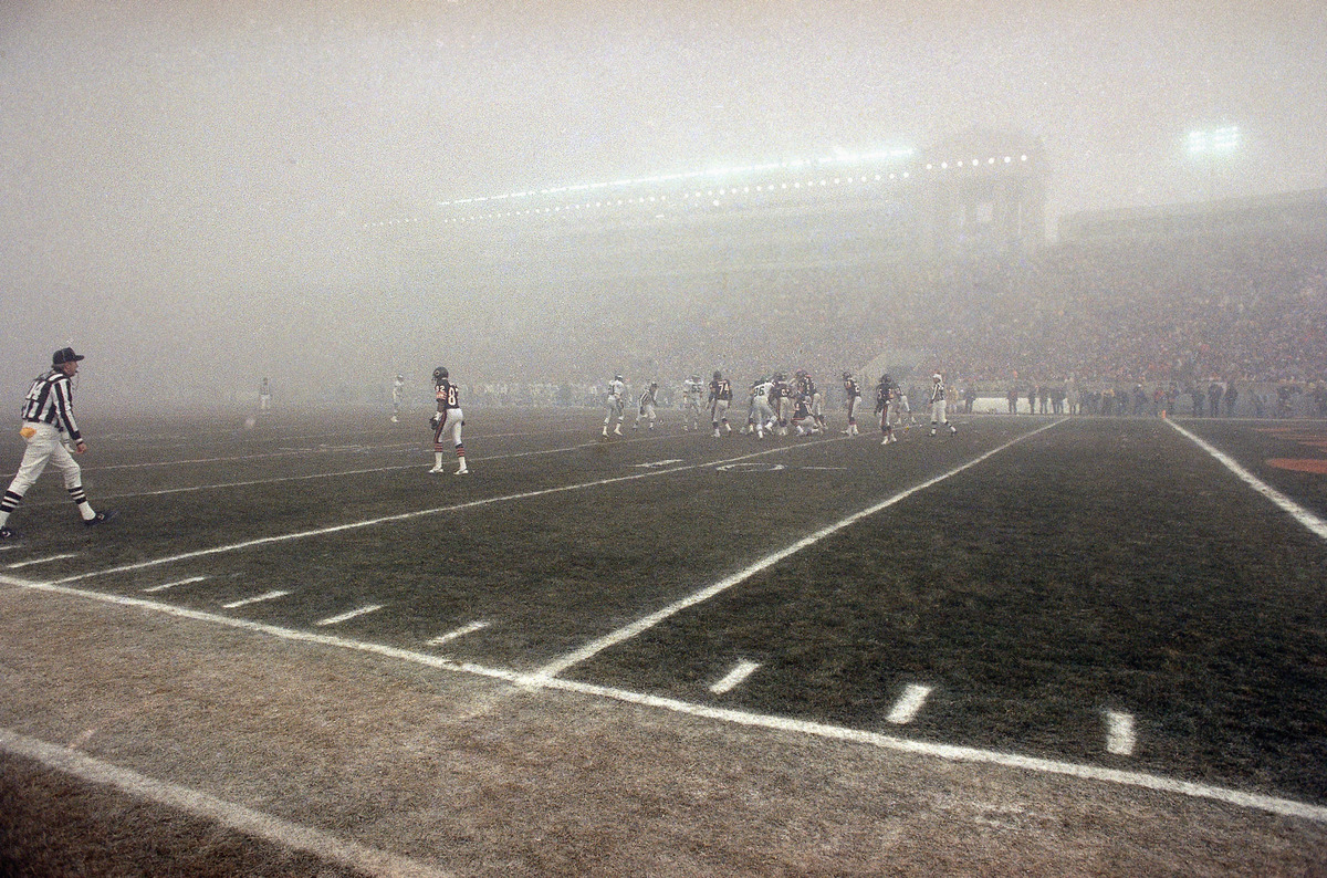 In this Dec. 31, 1988, file photo, lights shine through the fog during an NFL football playoff game between the Chicago Bears