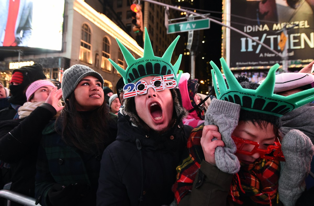 People gather to celebrate the New Year's Eve at the Times Square in New York on December 31, 2014.