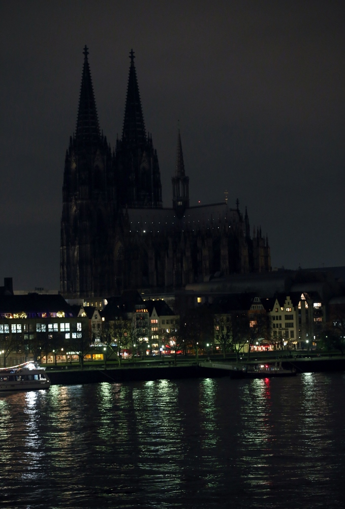 Lights to illuminate Cologne's landmark the Cologne Cathedral (C) are switched off in protest against a rally by a mounting r