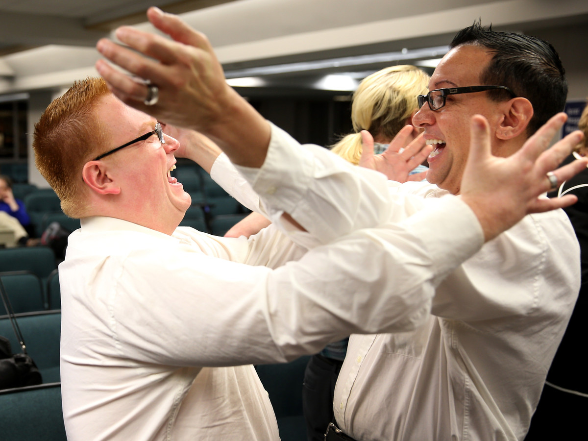 (L-R) Jonathon Infante-May and his husband Joseph Infante-May embrace after getting married during a ceremony at the Broward