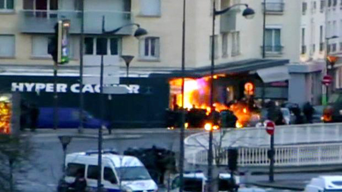 Members of the French police special forces launch the assault and evacuate the hostages at a kosher grocery store in Porte d