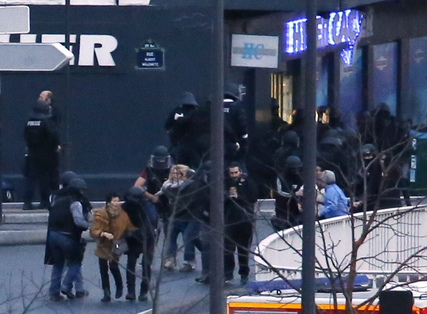 Members of the French police special forces evacuate the hostages after launching the assault at a kosher grocery store in Po