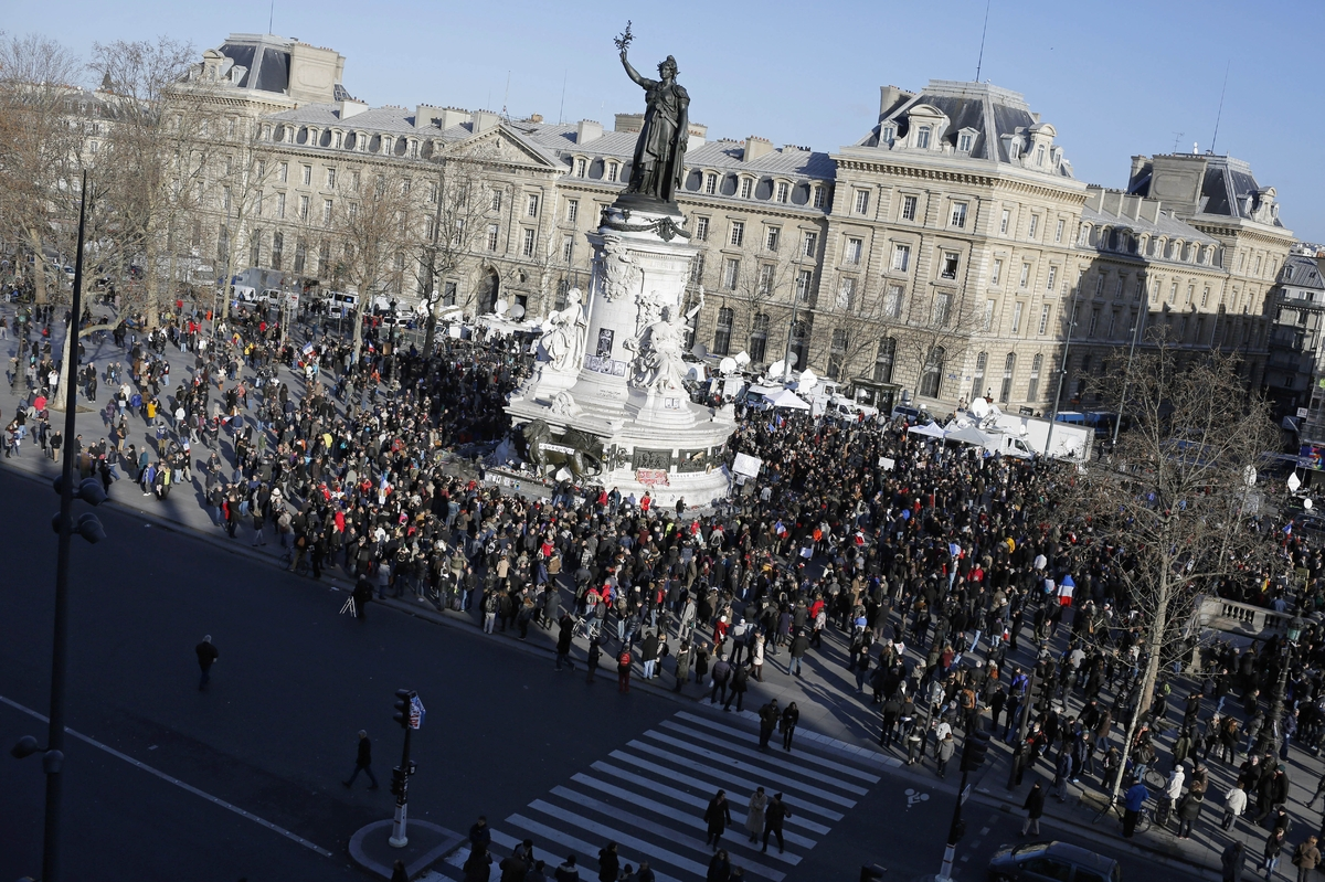 People start gathering at Republique square before the demonstration, in Paris, France, Sunday, Jan. 11, 2015. (AP Photo/Laur