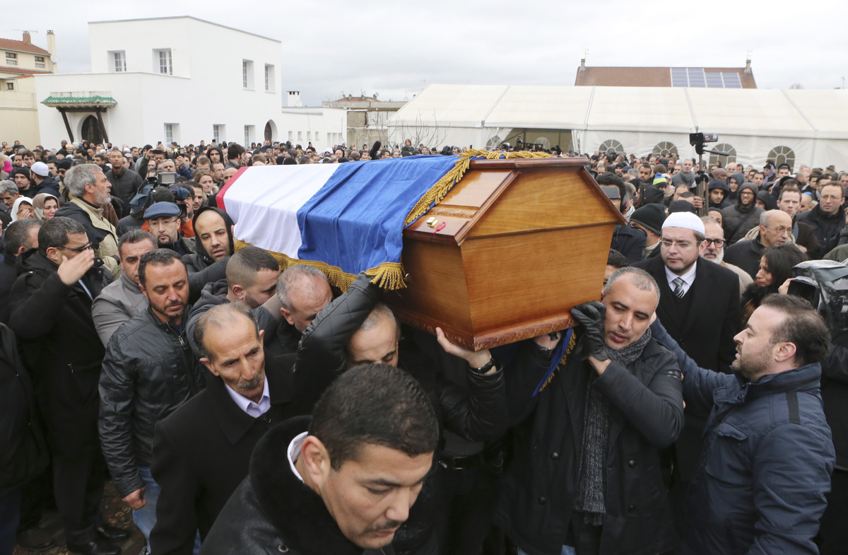 People carry the coffin of slain police officer Ahmed Merabet after a funeral service at the Bobigny Mosque, east of Paris, F