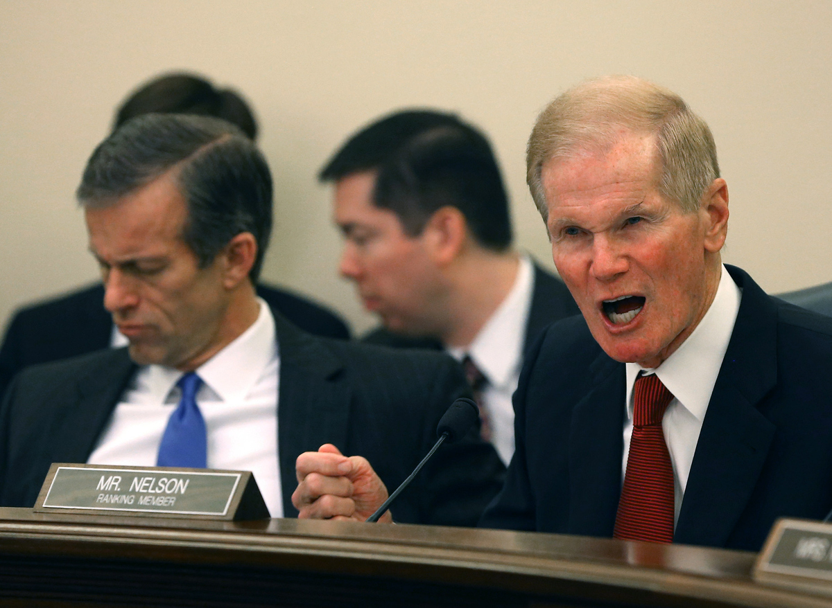 Sen. Bill Nelson (D-Fla.), right, speaks while flanked by Chairman John Thune (R-S.D.) during a Senate Commerce, Science and