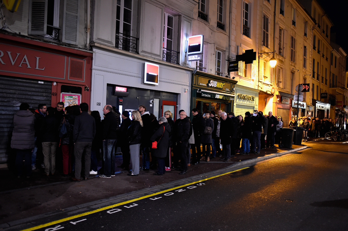 A queue of people wait outside a kiosk to get a copy of Charlie Hebdo on January 14, 2015 in Saint Germain en Laye, France. F
