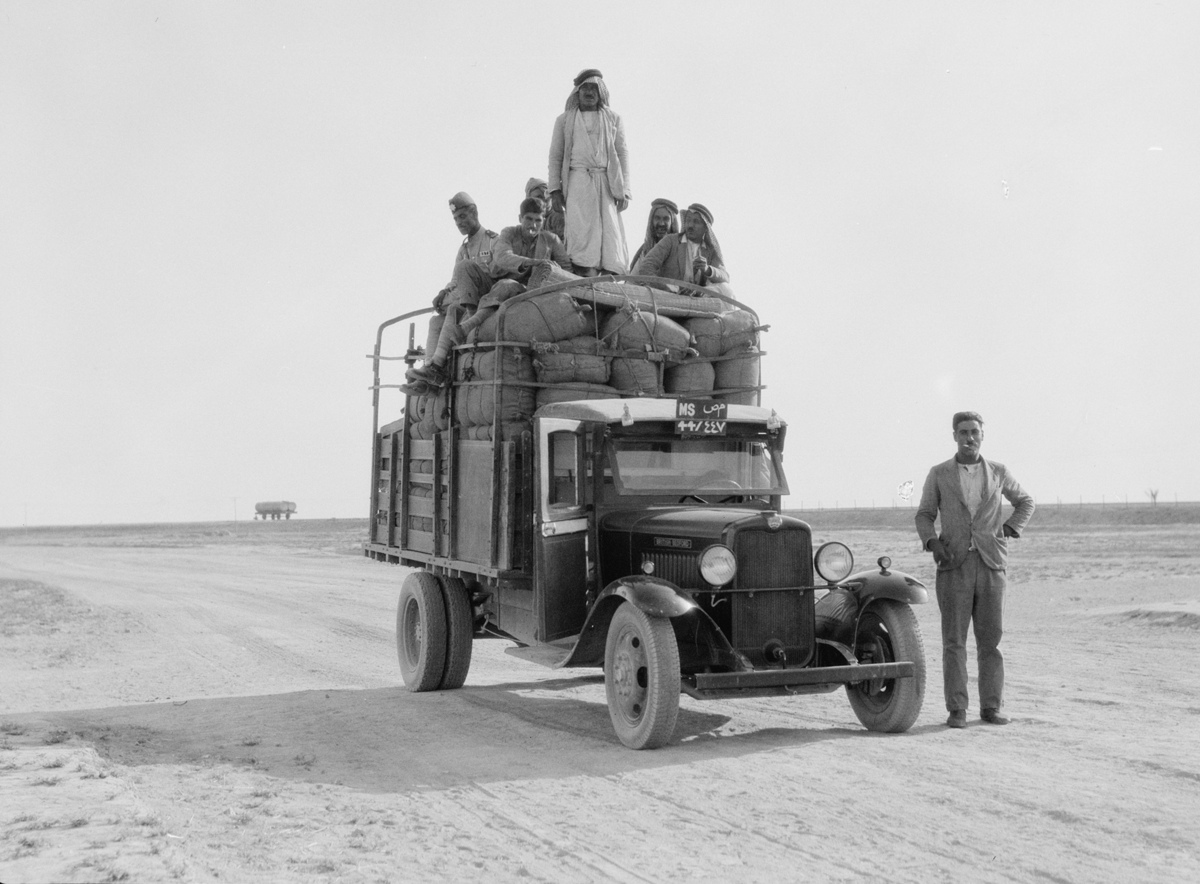 In this undated handout photo provided by the Library of Congress taken during the autumn of 1932, men pause on a lorry on th
