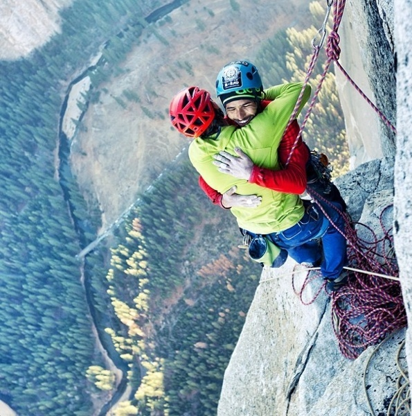 Kevin Jorgeson and Tommy Caldwell celebrate after completing the climb.