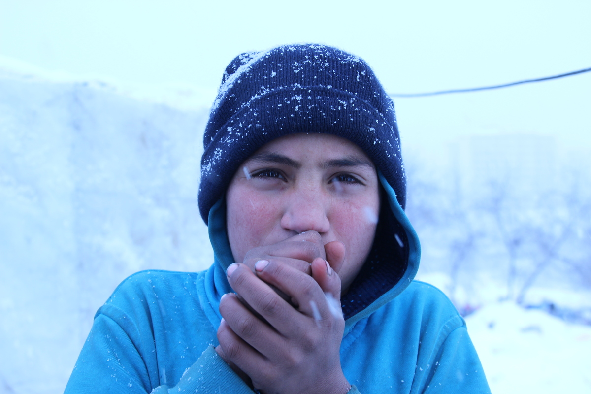We ask Yusuf, 11-year-old Syrian boy, what would make him happy the most in this cold weather. While he is trying to warm his